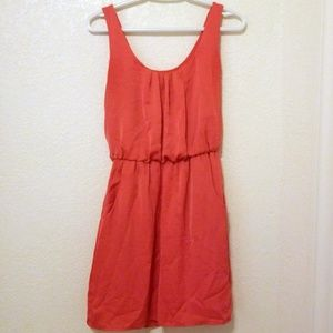 Coral sleeveless dress with pockets